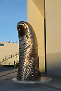 Thumb, 1994, bronze sculpture by Cesar, 1921-98, in the courtyard of La Seine Musicale, a music and performing arts centre, opened April 2017, on the Ile Seguin in the river Seine, between Boulogne-Billancourt and Sevres, in the Western suburbs of Paris, France. Jean Nouvel was the lead architect from 2009 and the main buildings were designed by Shigeru Ban and Jean de Gastines. The complex includes La Grande Seine, a large concert hall seating 6000 with a rotating solar panel fin, an auditorium for unamplified classical music, event or exhibition spaces and the Bellini Gardens. Picture by Manuel Cohen