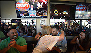 Michelle Grisham, Trent Clark's mother, hugs her son as John Guajardo, left, and Megan Buetow, right, celebrate him joining the Milwaukee Brewers as 15th pick at a watch party for the first day of the Major League Baseball draft at Pluckers in Fort Worth, Texas on Monday June 8, 2015.   (Robert W. Hart/Special Contributor)