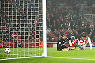 Yaya Sanogo of Arsenal scores the opening goal of the UEFA Champions League match past Roman Weidenfeller of Borussia Dortmund at the Emirates Stadium, London<br /> Picture by Richard Calver/Focus Images Ltd +447792 981244<br /> 26/11/2014