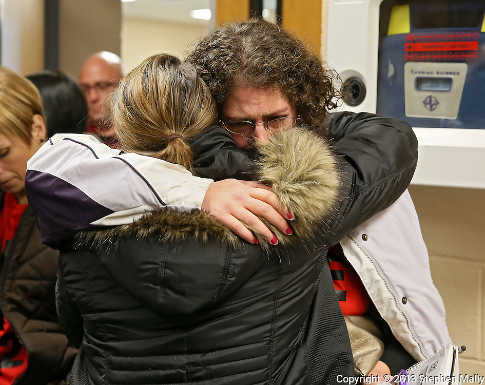 Jessica Andersen (from left) hugs Angie Lawrence both of Marion after the Linn-Mar Community School District Board of Education voted against their desired boundary plan during a meeting at the Linn-Mar Learning Resource Center in Marion on December 9, 2013.