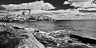 """A lighthouse was built on the """"nub"""" in 1879 to protect ships from the rocky coast of Maine at York. The last lighthouse operator, and his family, left in 1987 when the Nubble Lighthouse was automated. The living quarters remain as a tribute to its history."""