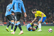 Brazil defender Filipe Luis (6) tells Uruguay forward Luis Suárez (9) to get up after a tackle during the Friendly International match between Brazil and Uruguay at the Emirates Stadium, London, England on 16 November 2018.