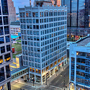 High angle view of downtown Kansas City  MO skyscrapers near 12th and Walnut Streets at dusk from rooftop deck of Wall Street Tower Condos.