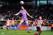 Plymouth Argyle's Jordan Houghton jumps high to head the ball during the Sky Bet League 2 match between Exeter City and Plymouth Argyle at St James' Park, Exeter, England on 2 April 2016. Photo by Graham Hunt.