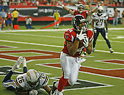 ATLANTA - AUGUST 29:  Wide receiver Eric Weems #14 of the Atlanta Falcons hauls in the game winning touchdown pass from teammate Chris Redman #8 as cornerback Simeon Castille #26 of the San Diego Chargers falls short during the game at the Georgia Dome on August 29, 2009 in Atlanta, Georgia.  The Falcons beat the Chargers 27-24.  (Photo by Mike Zarrilli/Getty Images)