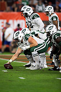New York Jets center Spencer Long (61) gets set to snap the ball near his own end zone during the 2018 NFL regular season week 3 football game against the Cleveland Browns on Thursday, Sept. 20, 2018 in Cleveland. The Browns won the game 21-17. (©Paul Anthony Spinelli)