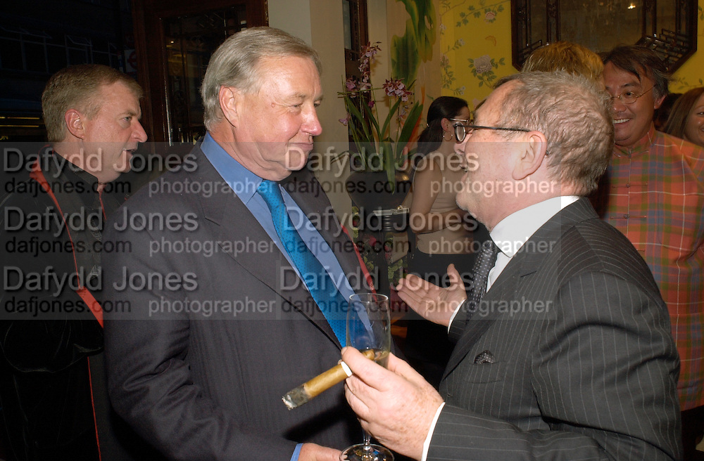 Sir Terence Conran and Joseph ettendui. Shanghai Tang opening. Sloane St. 11 April 2001. © Copyright Photograph by Dafydd Jones 66 Stockwell Park Rd. London SW9 0DA Tel 020 7733 0108 www.dafjones.com