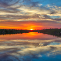 South Florida sunset photography from outdoor photographer Juergen Roth showing the edge of the Arthur R. Marshall Loxahatchee National Wildlife Refuge located west of Boynton Beach in Palm Beach County, FL. Arthur R. Marshall Loxahatchee National Wildlife Refuge is an amazing area for viewing wildlife and photography in Florida. <br /> <br /> Florida sunset photography images of the Arthur R. Marshall Loxahatchee National Wildlife Refuge area are available as museum quality photo prints, canvas prints, wood prints, acrylic prints or metal prints. Fine art prints may be framed and matted to the individual liking and decorating needs:<br /> <br /> https://juergen-roth.pixels.com/featured/florida-sunset-at-arthur-r-marshall-loxahatchee-national-wildlife-refuge-juergen-roth.html<br /> <br /> All digital nature photo images are available for photography image licensing at www.RothGalleries.com. Please contact me direct with any questions or request.<br /> <br /> Good light and happy photo making!<br /> <br /> My best,<br /> <br /> Juergen<br /> Prints: http://www.rothgalleries.com<br /> Photo Blog: http://whereintheworldisjuergen.blogspot.com<br /> Instagram: https://www.instagram.com/rothgalleries<br /> Twitter: https://twitter.com/naturefineart<br /> Facebook: https://www.facebook.com/naturefineart