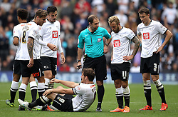 Derby County players surround the felled Chris Martin of Derby County - Mandatory byline: Robbie Stephenson/JMP - 07966 386802 - 03/10/2015 - FOOTBALL - iPro Stadium - Derby, England - Derby County v Brentford - Sky Bet Championship