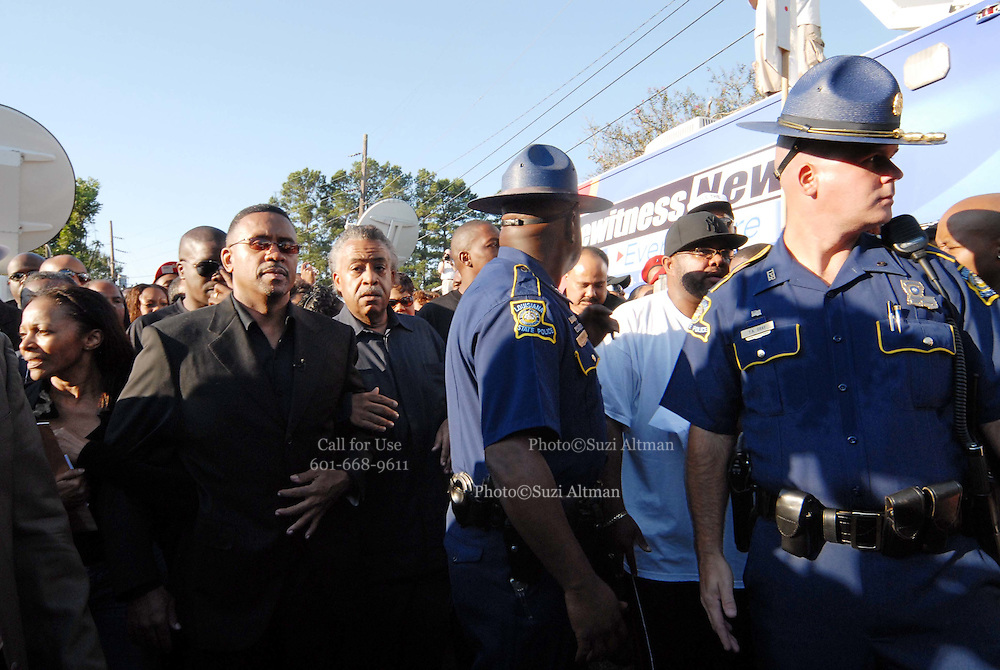 Rev Al Sharpton is surrounded by Louisiana State Patrolmen as he leaves the LaSalle Parish Court house.Thousands gather outside the LaSalle Parish court house and show their support for the Jena 6 as  Rev. Al Sharpton arrives in Jena Louisiana, Thursday Sept. 20,2007. Sharpton was there to speak to the crowd and demand justice for the Jena 6 in and aks the marchers to be calm, respectful and peaceful.  Louisiana Thursday Sept. 2007.(Photo/© Suzi Altman)
