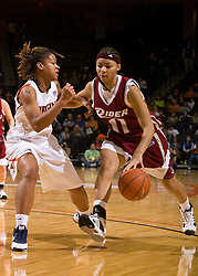 Rider guard/forward Tammy Meyers (11) is guarded by Virginia guard Kristen London (20).  The #15 ranked Virginia Cavaliers defeated the Rider Broncs 83-38 in the Marriott Cavalier Classic Basketball Tournament at the John Paul Jones Arena on the Grounds of the University of Virginia in Charlottesville, VA on December 28, 2008.