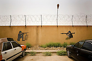 MOSUL, IRAQ - JUNE 05: Paintings of Iraqi police wielding weapons adorn the wall of the Iraqi Army's 2nd Division barracks, on June 5 , 2010, in Mosul, Iraq. Iraq faces multiple challenges in the lead-up to the drawn-down of US forces in Iraq, with many observers claiming that while they have the capablities of handling home-grown problems, they are far from being able to tackle external threats. Political wrangling has reportedly fostered greater instability throughout the country with fears of renewed sectarian violence breaking out as insurgents set-up attacks in an attempt to exploit vulnerabilities amongst the populace. (Photo by Warrick Page)