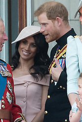 © Licensed to London News Pictures. 09/06/2018. London, UK.  MEGHAN DUCHESS OF SUSSEX and the DUKE OF SUSSEX on the balcony of Buckingham Palace after attending Trooping The Colour ceremony in London. This years event is part of a weekend of celebration to mark the 92th birthday of Queen Elizabeth II, who is Britain's longest reigning monarch.Photo credit: Ray Tang/LNP