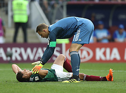 MOSCOW, June 17, 2018  Goalkeeper Manuel Neuer (top) of Germany pulls up Javier Hernandez of Mexico after his injury during a group F match between Germany and Mexico at the 2018 FIFA World Cup in Moscow, Russia, June 17, 2018. (Credit Image: © Xu Zijian/Xinhua via ZUMA Wire)