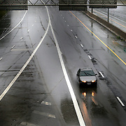 A single motorist drives southbound on I-75 in the rain in Toledo on Monday, July 10, 2017. THE BLADE/KURT STEISS