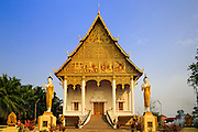 09 MARCH 2013 - VIENTIANE, LAOS:  Wat That Luang Neua on the north side of Pha That Luang is the home temple of Laos' Supreme Buddhist Patriarch. Pha That Luang is the most important Buddhist site in Laos and is the country's national symbol. It's likeness is on currency. It's said to date back to the 3rd century BC, but archeological and historic records indicate that construction on the site started in 1566. A piece of the Buddha's breast bone is thought to be in the stupa.  PHOTO BY JACK KURTZ