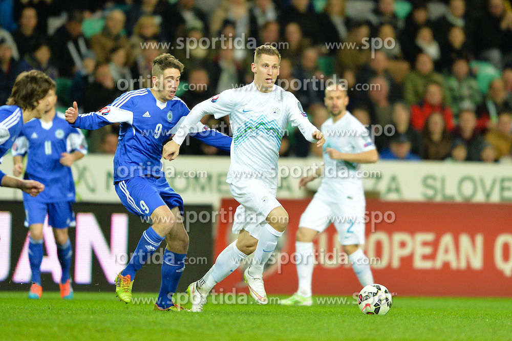 Birsa Valter of Slovenia vs Tosi Luca of San Marino during football match between NationalTeams of Slovenia and San Marino in Round 5 of EURO 2016 Qualifications, on March 27, 2015 in SRC Stozice, Ljubljana, Slovenia. Photo by Mario Horvat / Sportida