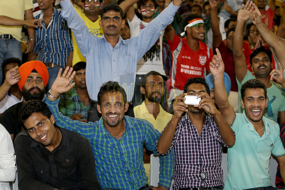 Crowd enjoying the atmosphere during match 2 of the Oppo Champions League Twenty20 between the Kings XI Punjab and the Hobart Hurricanes held at the Punjab Cricket Association Stadium, Mohali, India on the 18th September 2014. Photo by:  Jacques Rossouw / Sportzpics/ CLT20<br /> <br /> <br /> Image use is subject to the terms and conditions as laid out by the BCCI/ CLT20.  The terms and conditions can be downloaded here:<br /> <br /> http://sportzpics.photoshelter.com/gallery/CLT20-Image-Terms-and-Conditions-2014/G0000IfNJn535VPU/C0000QhhKadWcjYs