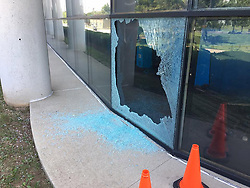 May 30, 2017 - USA - An apparent bullet hole in one of the press room windows in the Lexington Herald-Leader building on Sunday May 28, 2017 in Lexington, Ky. Several exterior windows were damaged on the first-, second- and third-level banks of windows of the press room on the Midland Avenue side of the building. Three exterior windows were shattered, leaving broken glass on the sidewalk outside. Two windows on the upper level of the press room were damaged, but did not shatter. Those windows show small holes and cracks that appear consistent with small-caliber bullet damage. (Credit Image: © Peter Baniak/TNS via ZUMA Wire)