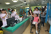 ZHENGZHOU, CHINA - AUGUST 19: (CHINA OUT)<br /> <br /> A Girl Has A Big Leg<br /> <br /> Sun Jingjing waves goodbye to nurses at Armed Police Corps Hospital of Henan on August 19, 2013 in Zhengzhou, Henan Province of China. 22-year-old Sun Jingjing, who was born with congenital angiolipoma in her right leg, underwent a leg-amputation surgery on July 23. And the hospital will offer her a prosthesis free of charge in three months. Sun Jingjing comes from a poor family in Baibi town of Anyang city, Henan province. She had never received any adequate treatment before, the circumference of her right leg was 85cm when her story was published by local media two months ago. Her father died by uremia 12 years ago, and her mother is suffering from esophageal cancer. They live on subsistence allowance from the local government.<br /> ©Exclusivepix