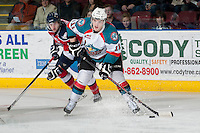 KELOWNA, CANADA - MARCH 22: Carter Rigby #11 of the Kelowna Rockets looks for the pass against the Tri-City Americans on March 22, 2014 at Prospera Place in Kelowna, British Columbia, Canada.   (Photo by Marissa Baecker/Shoot the Breeze)  *** Local Caption *** Carter Rigby;