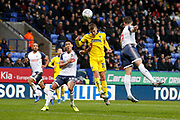 Marcus Forss of Wimbledon heads just over during the EFL Sky Bet League 1 match between Bolton Wanderers and AFC Wimbledon at the University of  Bolton Stadium, Bolton, England on 7 December 2019.