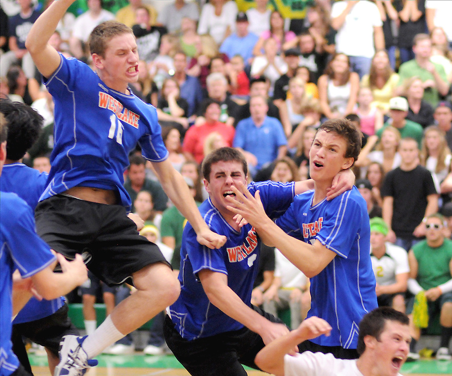 H:\EDITORIAL\Photos\06 June 2009\JH 6-4-09 from left Chris Balay, Jake Kneller, Travis Magorien, and Nick Weaver celebrate after the Warriors beat Royal High School in five games to claim the school's first volleyball CIF Championship at Thousand Oaks High School on Saturday, May 30.