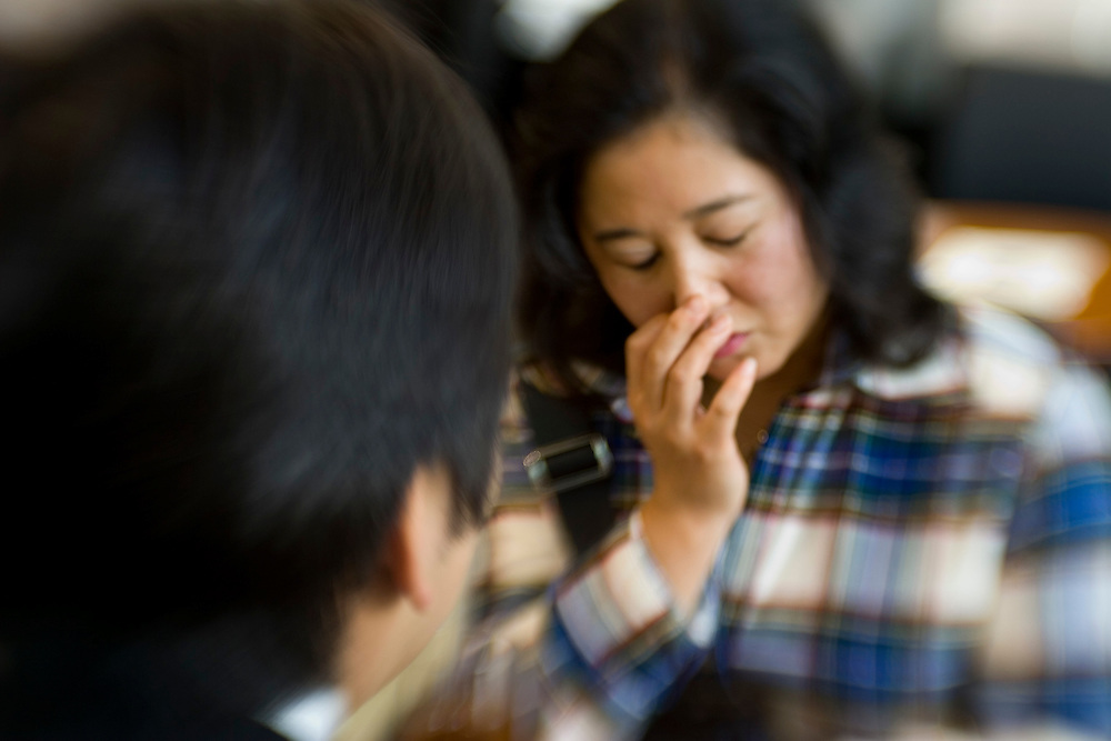 "Shizuka, 40, is one of growing numbers of women in so-called ""sexless marriages"" in Japan. She turned to the volunteer service soon after she hit her 40th birthday, fearing that she would never have sex again if she didn't take action. Here she is pictured with her ""volunteer"", a 42-year-old bank employee who ""loves women""."