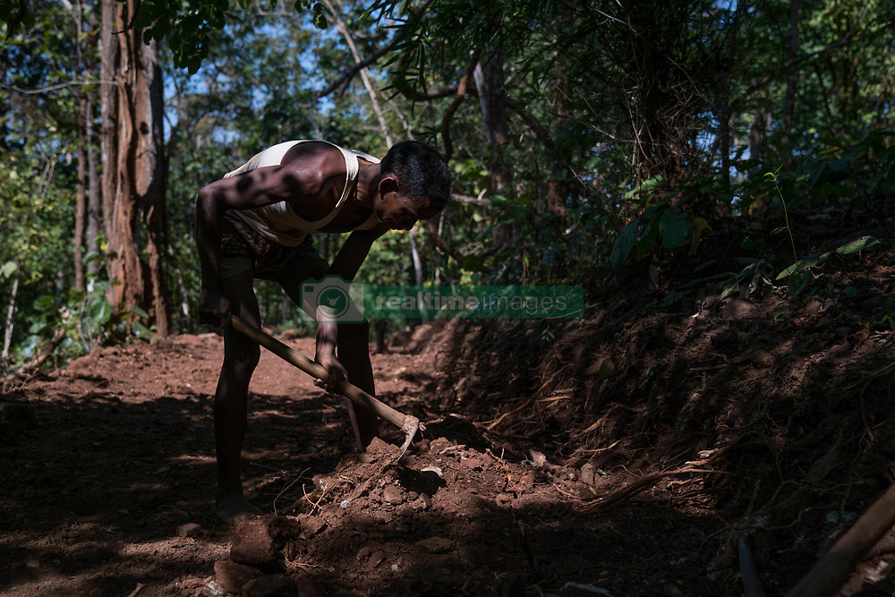 """EXCLUSIVE: By Sanjay Pandey in India A 50-year-old Indian man has singlehandedly scraped though hills for a period of two years to make an 8km stretch of road to ensure that he and wife can meet their school-going children more often. Jalandhar Nayak, a small-time farmer from Kandhamal district of east Indian state of Odisha, constructed the first stretch of the road all by himself with just a pick axe and crowbar by working from dawn to dusk since 2016. So how did he stumbled up on the idea? """"At the time of birth of our first child, my wife was home. When she went into labour pain, I tried to take her to the nearby health centre. But we couldn't reach there in time and she had to deliver the baby on the way. It was then the idea of building a road struck me first. I thought to myself, if having no roads in the village is causing us so much of problem to us, it would cause the problem to our children, too,"""" said Nayak, explaining how he stumbled upon the idea of contracting road."""" According to the Nayaks, the government has been giving assurance of building a road for decades in the area, but they never moved anything on the ground. Jalandhar's father father who is 80 now, tells about the same hollow assurances that he got from the administration in his youth.  """"When my children grew up and started going to school, it would take them three hours one way to go the school trekking though the mountainous terrain. Since they cannot commute to and from the school everyday, we had to get them enrolled in a residential school, a 15km away from home.  Nayak's children spend six days in the school and return home on seventh day. But trekking though five hills is not a child play, the journey used to make them tired and exhausted. """"This made me more determined to tear though the mighty mountains to pave way for my children. I didn't want my children to meet the same fate as mine. Hence, I decided to go ahead with the plan of road construction -- with or withou"""