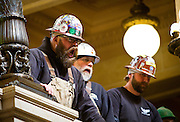 MADISON, WI — FEBRUARY 24: Kevin Flynn, left, and other Local 150 Chicago members chant in the Rotunda of the Wisconsin State Capitol on Tuesday, February 24. Workers and labor unions rallied in opposition to a right-to-work bill being discussed in the state legislature.
