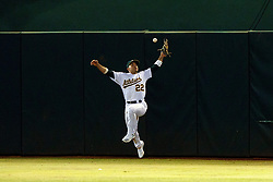 OAKLAND, CA - SEPTEMBER 16: Ramon Laureano #22 of the Oakland Athletics leaps for but is unable to catch a fly ball hit off the bat of Whit Merrifield (not pictured) of the Kansas City Royals during the ninth inning at the RingCentral Coliseum on September 16, 2019 in Oakland, California. The Kansas City Royals defeated the Oakland Athletics 6-5. (Photo by Jason O. Watson/Getty Images) *** Local Caption *** Ramon Laureano