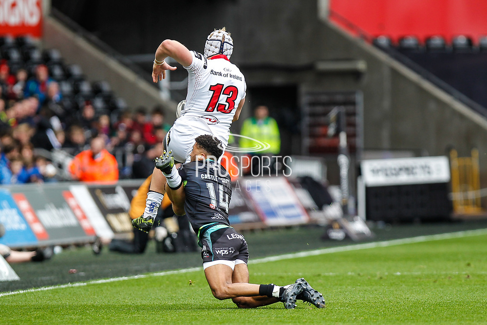 Ospreys wing Keelan Giles tackles Ulster centre Luke Marshall during the Guinness Pro 12 2017 Round 21 match between Ospreys and Ulster at the Liberty Stadium, Swansea, Wales on 29 April 2017. Photo by Andrew Lewis.