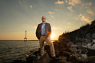 Jamin Wells, Director, Graduate Program in Public History, Assistant Professor, Department of History along the Pensacola Bay waterfront Monday October 29, 2018 in Pensacola, Florida.(Michael Spooneybarger/ Division of Research and Strategic Innovation)