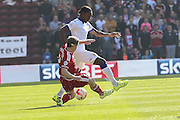 Middlesbrough midfielder Grant Leadbitter tackles Leeds United forward Jordan Botaka during the Sky Bet Championship match between Middlesbrough and Leeds United at the Riverside Stadium, Middlesbrough, England on 27 September 2015. Photo by Simon Davies.