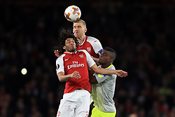 14 September 2017 -  UEFA Europa League (Group H) - Arsenal v FC Koln - Per Mertesacker and Mohamed Elneny of Arsenal collide challenging for the same ball - Photo: Marc Atkins/Offside