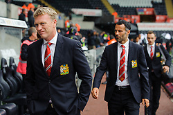 Man Utd Manager David Moyes (SCO) and Midfielder Ryan Giggs (WAL) arrive at the stadium before the start of the match - Photo mandatory by-line: Rogan Thomson/JMP - Tel: Mobile: 07966 386802 17/08/2013 - SPORT - FOOTBALL - Liberty Stadium, Swansea -  Swansea City V Manchester United - Barclays Premier League - First round of the 2013/14 season and the first league match for new Man Utd manager David Moyes.
