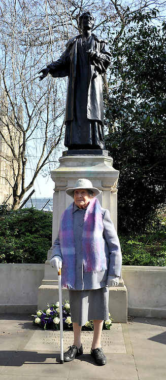 London News pictures. 08/03/11. 105-year-old former suffragette Hetty Bower at the statue of Emmeline Pankhurst to mark International Women's Day. She was  joined by Labour Leader Ed Miliband, Labour Deputy Leader Harriet Harman, and shadow home secretary Yvette Cooper. Emmeline  at the Pankhurst statue at Victoria Tower Gardens, Parliament Square, Westminster, London, Picture Credit should read Stephen Simpson/LNP