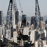 """The view of Hong Kong with more building works in process. <br /> Hong Kong (香港; """"Fragrant Harbour""""), officially known as Hong Kong Special Administrative Region of the People's Republic of China since the hand-over from the United Kingdom in 1997 under the principle of """"one country, two systsems"""".  7 million people live on 1,104km square, making it the most vertivcal city in the world. Hong Kong is one of the world's leading financial centres along side London and New York, it has one of the highest income per capita in the world as well the moste severe income inequality amongst advanced economies. The Hong Kong civil society is highly regulated but has at the same time one of the most lassiez-faire economies with low taxation and free trade. Civil unrest and political dissent is unusual but in 2014 the Umbrella Movenment took to the streets of Hong Kong demanding democracy and universal suffrage. 93 % are ethnic Chinese, mostly Cantonese speaking."""