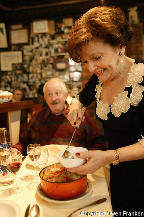 "for story by RW Apple....Pot au Feu in the Parisian bistro ""Chez la Vieille - 'Adrienne' ""....It is being served by Marie-Jose Cervoni, the owner and hostess....photo by Owen Franken ....February 5,  2004......"