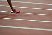 Great Britain, London - 2017 August 13: Hand with stick leans on the track before women&rsquo;s 4x400 meters relay final during IAAF World Championships London 2017 Day 10 at London Stadium on August 13, 2017 in London, Great Britain.<br /> <br /> Mandatory credit:<br /> Photo by &copy; Adam Nurkiewicz<br /> <br /> Adam Nurkiewicz declares that he has no rights to the image of people at the photographs of his authorship.<br /> <br /> Picture also available in RAW (NEF) or TIFF format on special request.<br /> <br /> Any editorial, commercial or promotional use requires written permission from the author of image.