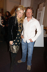 Actress KATRINE BOORMAN and her brother CHARLEY BOORMAN at a party to celebrate the opening of Photo-London 2006 at Burlington Gardens, London W1 on 17th May 2006.<br />