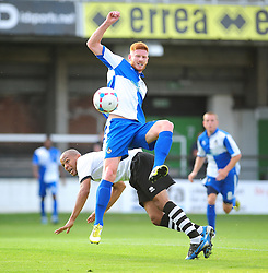 Bristol Rovers' Matt Harrold battles for the ball in the air - Photo mandatory by-line: Dougie Allward/JMP - Tel: Mobile: 07966 386802 16/07/2013 - SPORT - FOOTBALL - Bristol -  Hereford United V Bristol Rovers - Pre Season Friendly