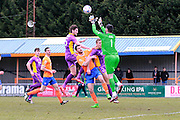 Cameron Burgess attempts a header towards goal during the Vanarama National League match between Braintree Town and Cheltenham Town at the Amlin Stadium, Braintree, United Kingdom on 19 March 2016. Photo by Carl Hewlett