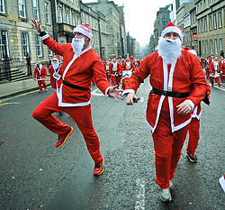 More than 8000 runners, all dressed as Santa, took part in the annual charity fun run thru the centre of Glasgow, to raise money for charity.<br /> <br /> © Dave Johnston/ EEm