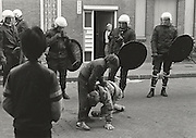 Kids play acting for riot squad, Staatsliedenbuurt Amsterdam 1985