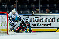 KELOWNA, CANADA - OCTOBER 5:  Tanner Sidaway #22 of the Victoria Royals back checks Lassi Thomson #2 of the Kelowna Rockets behind the net during first period on October 5, 2018 at Prospera Place in Kelowna, British Columbia, Canada.  (Photo by Marissa Baecker/Shoot the Breeze)  *** Local Caption ***