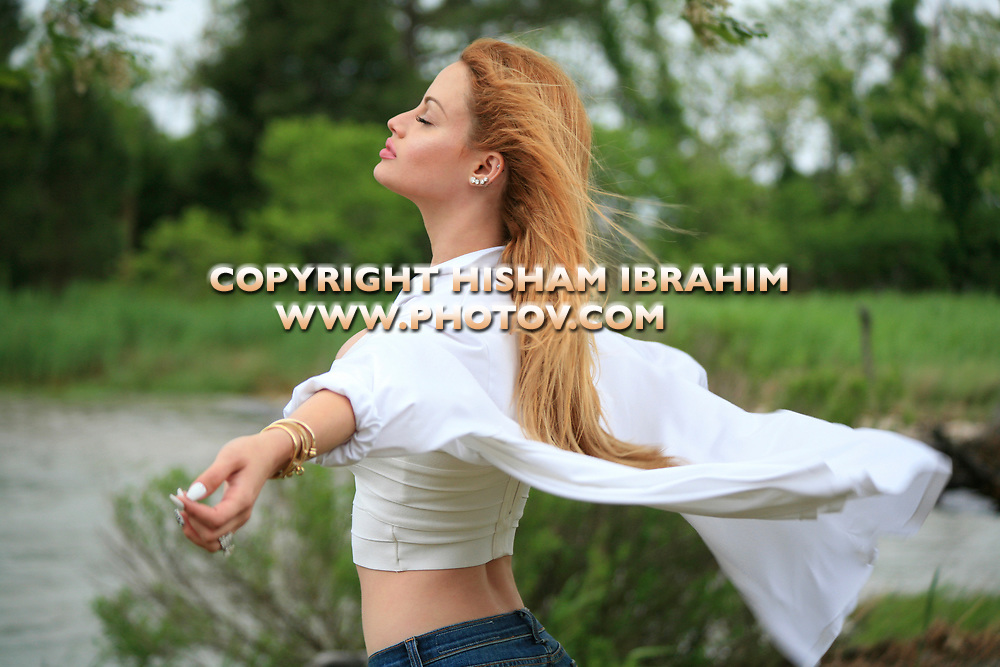 Young woman breathing fresh air feeling free.
