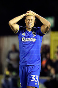 AFC Wimbledon striker Lyle Taylor (33) with hands on head during the EFL Sky Bet League 1 match between AFC Wimbledon and Milton Keynes Dons at the Cherry Red Records Stadium, Kingston, England on 22 September 2017. Photo by Matthew Redman.