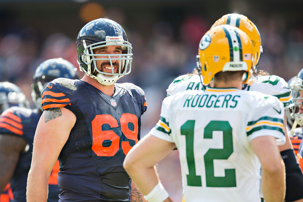 CHICAGO, IL - SEPTEMBER 13:  Jared Allen #69 of the Chicago Bears talks with Aaron Rodgers #12 of the Green Bay Packers during a time out at Soldier Field on September 13, 2015 in Chicago, Illinois.  The Packers defeated the Bears 31-23.  (Photo by Wesley Hitt/Getty Images) *** Local Caption *** Jared Allen; Aaron Rodgers