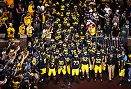Oct 7, 2017; Ann Arbor, MI, USA; Michigan Wolverines head coach Jim Harbaugh (right) gets set to lead the tam onto the field prior to the game against the Michigan State Spartans at Michigan Stadium. Mandatory Credit: Rick Osentoski-USA TODAY Sports
